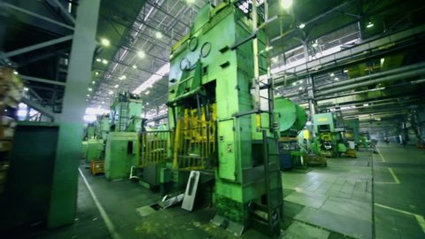 TOGLIATTI - SEP 30: Rows of huge machines at workshop of factory VAZ, (shown in motion) on September 30, 2011, Togliatti, Russia. AvtoVAZ factory was founded in 1966