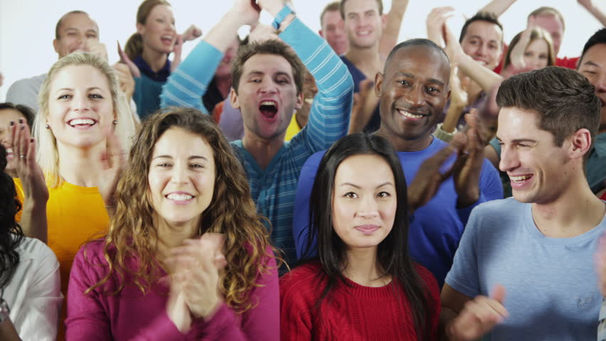 Portrait of a happy and diverse multi-ethnic group of people in colorful casual clothing, isolated on white in a studio shot. They are all clapping and cheering. In slow motion. | Shutterstock HD Video #4010689