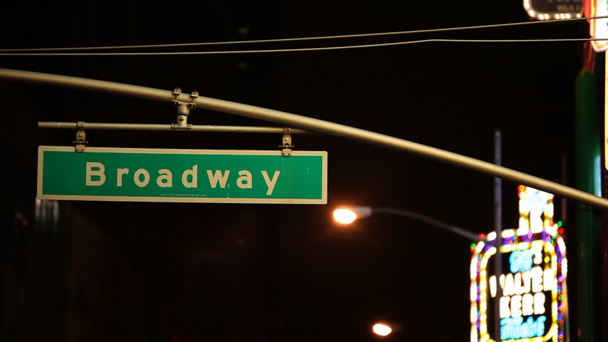 Broadway Traffic sign illuminated by colorful neon lights / HD1080 / 29.97fps /