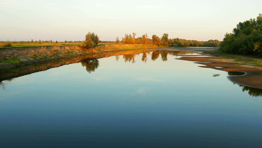 Aerial View. Flying over the beautiful autumn River. Aerial camera shot. Altai, Siberia.