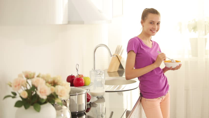 Teenager Standing In Kitchen And Eating Cornflakes Stock Footage ...