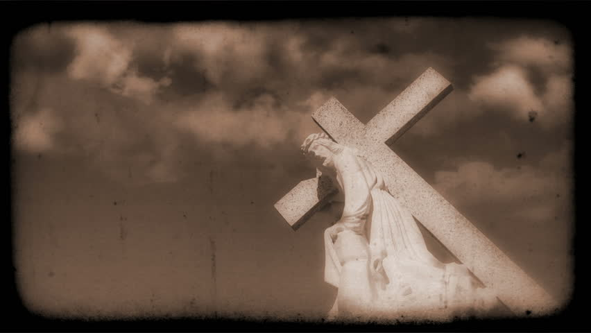 Vintage Film of crucifix with Clouds moving in the background