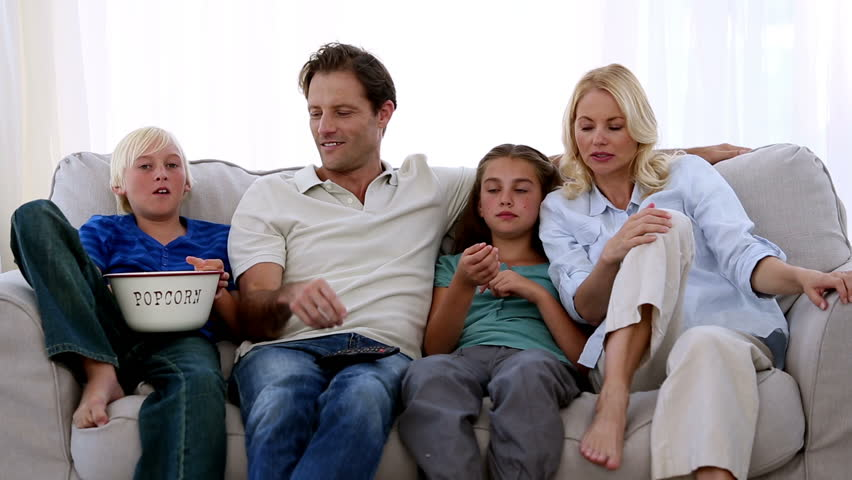 Famil Watching Tv And Eating Popcorn At Home On The Couch   HD Stock Video  Clip