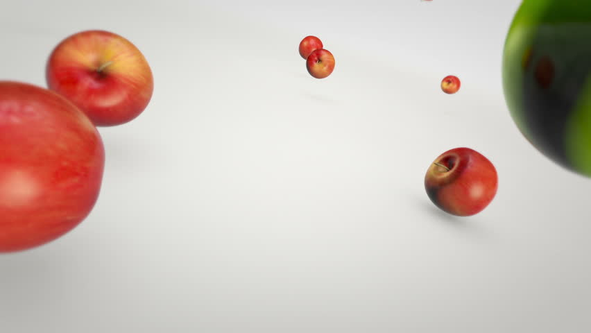 Red and Green apples are falling in slow-motion.