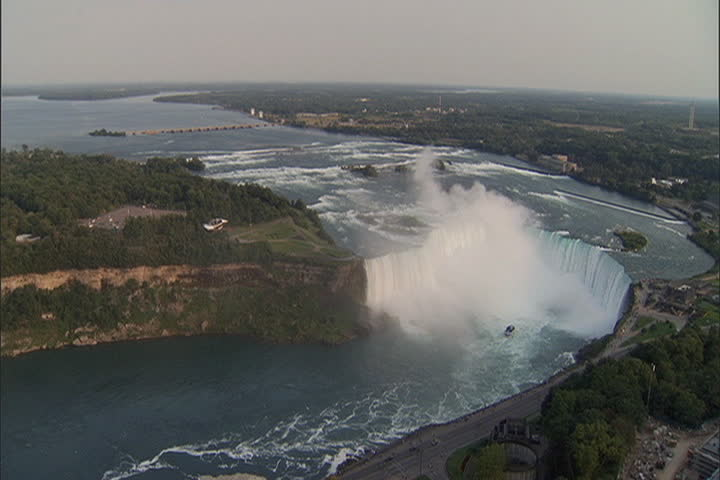High angle view of river and Horseshoe Falls with lots of white mist rising from the falls at Niagara Falls, Ontario, Canada.