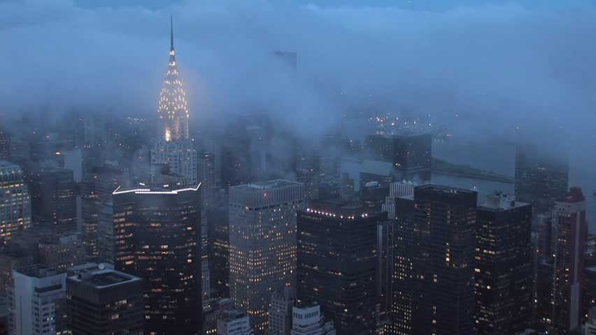 time lapse clouds over new york city at night