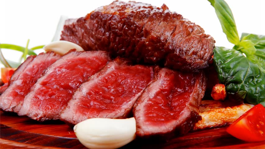 Roast steak on potato : fresh grilled beef meat on wood plate with pepper and tomato 1920x1080 intro motion slow hidef hd | Shutterstock HD Video #4090309