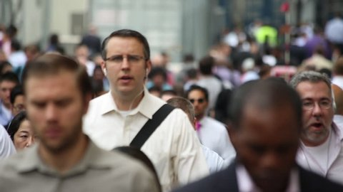 NEW YORK - CIRCA JUNE 2013: Commuter crowd of business people walking