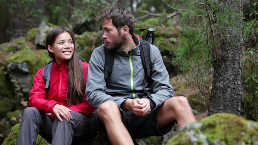 Hiking couple. Young people hikers having fun outdoors in forest.Multiracial couple, Asian woman, Caucasian man. From La Caldera, Aguamansa, La Orotava, Tenerife, The Canary Islands, Spain. | Shutterstock HD Video #4098769