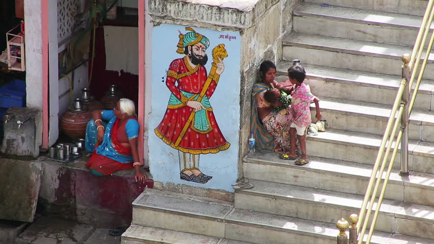 UDAIPUR, RAJASTHAN, INDIA - APRIL, 2013: Everyday scene with mother and children sitting in street | Shutterstock HD Video #4104769