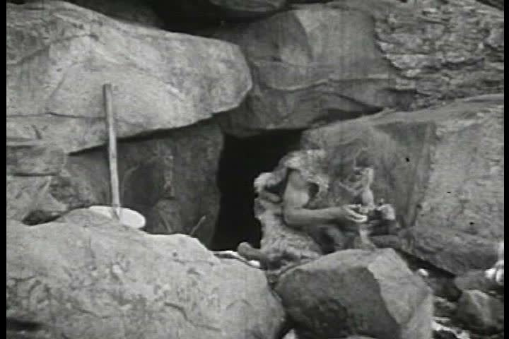 1930s - Funny footage of cavemen being scared by wild animals. #4105849