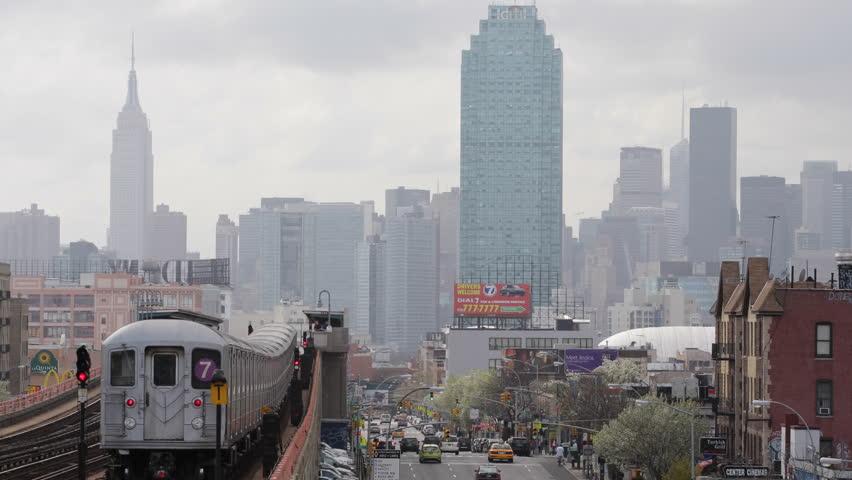 NEW YORK CITY, USA - APRIL 19, 2013 New York City Skyline, Elevated Metro Train Line 7 Pass in Queens, Manhattan