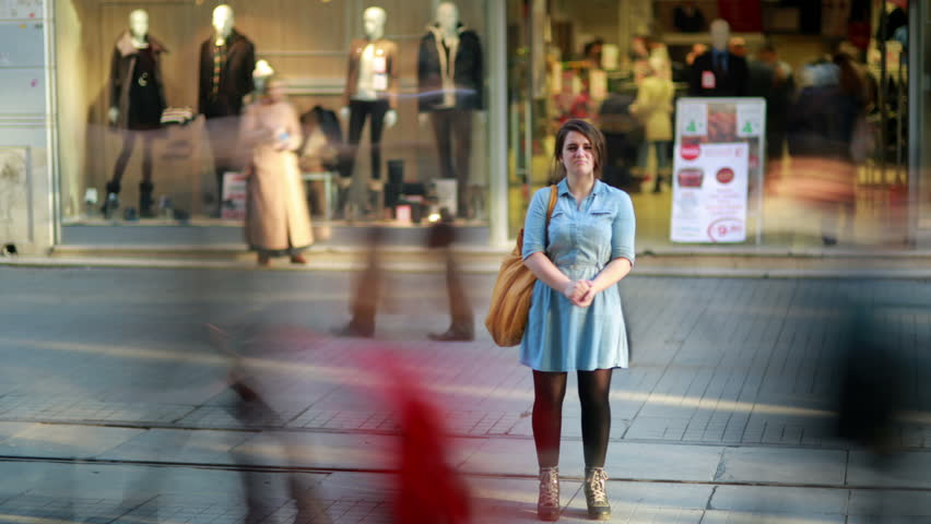 Young woman posing in front of shopping mall time lapse | Shutterstock HD Video #4106332