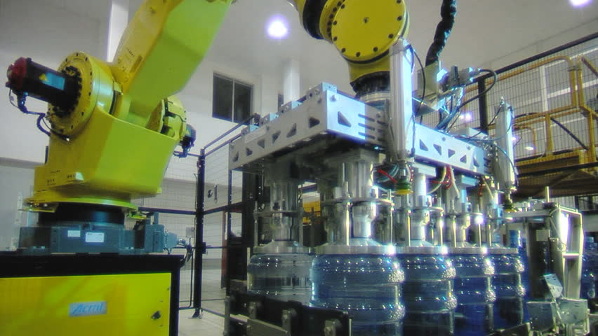 Stock Footage Servo-controlled robot in the bottled water factory.