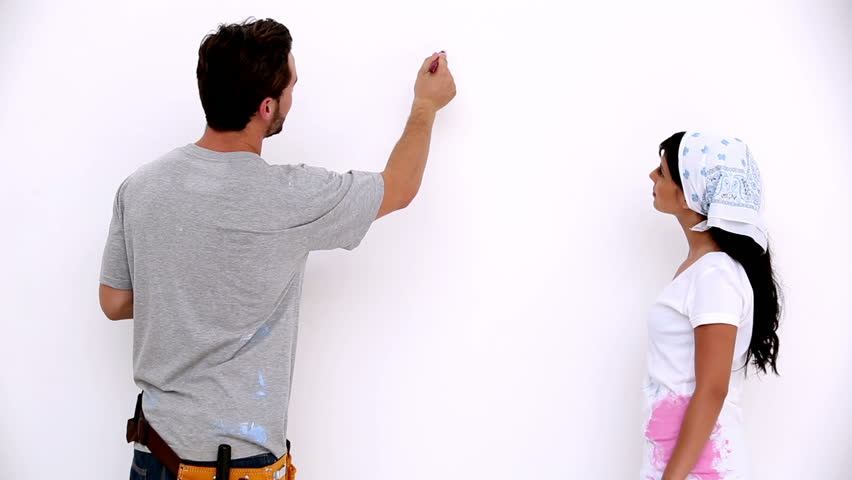 Painting White Walls the guy and the girl finished painting the walls stock footage
