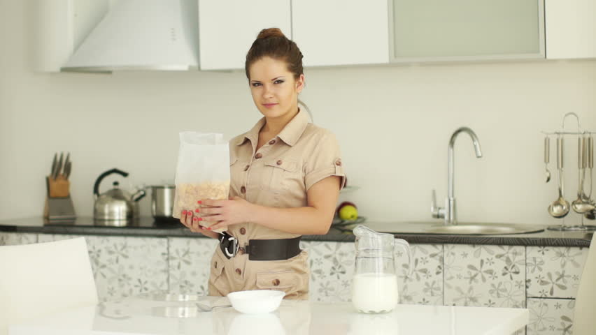 Woman Standing In Kitchen With Cornflakes And Milk Stock Footage ...