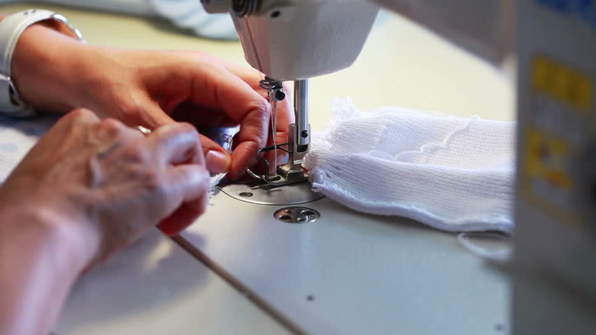 Seamstress sews children's clothes on machine #4139629