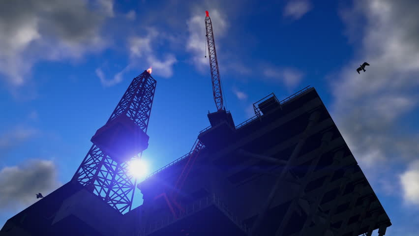 Oil Rig against blue sky, time lapse night to day