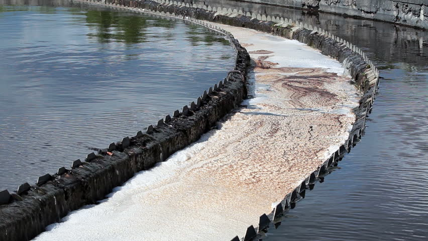 Water overflow from the big sedimentation drainages round form. Water treatment plant