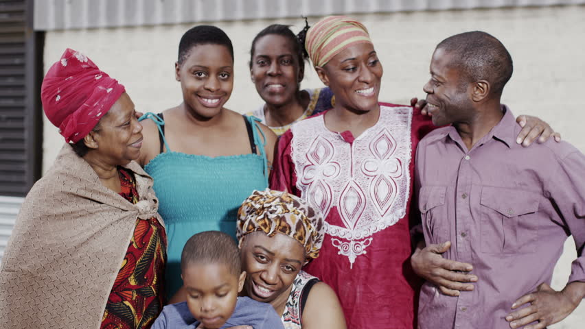Portrait of a smiling family group from an African village. In slow motion.