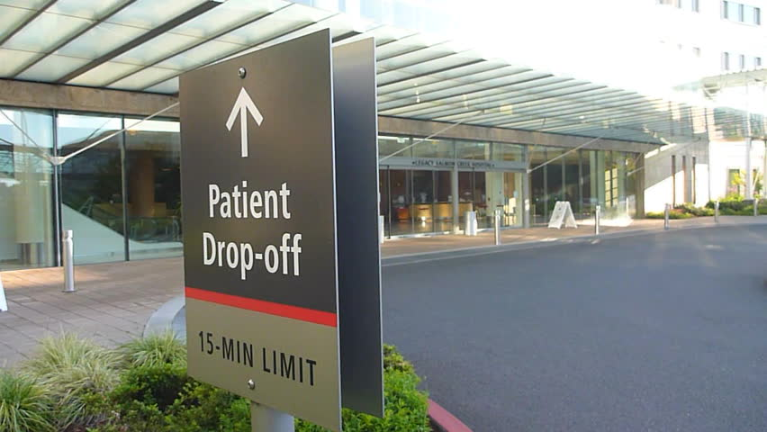 LEGACY HOSPITAL, WASHINGTON - CIRCA 2013: Hospital entrance exterior with sign reading, patient drop off.