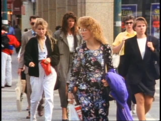 WINNIPEG, MANITOBA - CANADA - CIRCA - 1990: Crowd of people on sidewalk, Winnipeg, Manitoba, Canada, shot in 1990