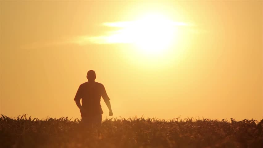 silhouette of a man at sunrise,silhouette of a man walking at sunrise