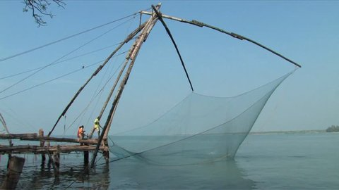 COCHIN, INDIA - JANUARY 25, 2009:  Found in fish market area of Cochin, India are the famous Chinese fishing nets believed to have been brought by traders from Kubla Kahn's court in China.