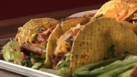 Several tacos and quesadillas