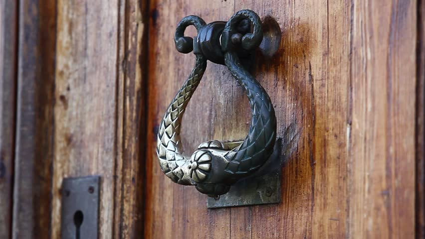 old a door knocker on the oak doors