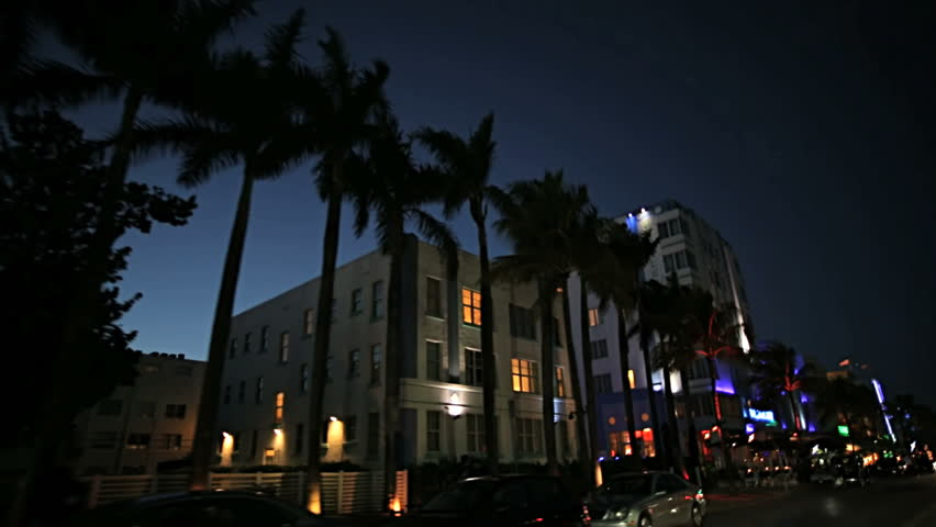 Night P.O.V. driving by illuminated restaurants on Ocean Drive Miami Art deco district of South Beach Florida, USA #4231999
