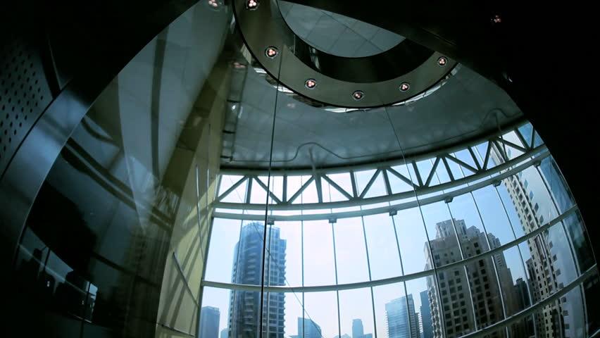 Moving elevator within city skyscraper Downtown Financial District, Dubai, UAE | Shutterstock HD Video #4234949