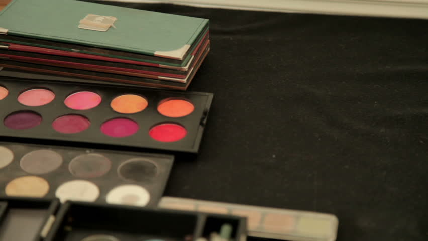 Make up artist accessories are gradually revealed as the camera slowly tilts down.