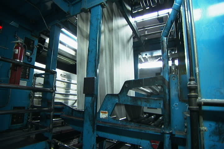 Huge sheets of newspaper moving vertically through printing presses in Los Angeles, California. | Shutterstock HD Video #4282439