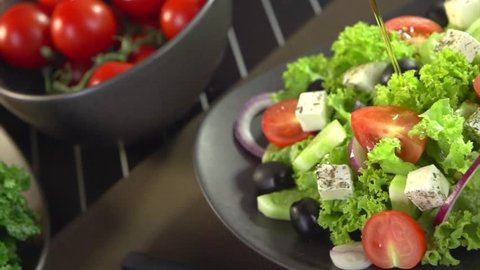 Greek Salad Preparing. Olive Oil Pouring. Salad Dressing. Cooking. Healthy Food. Slow Motion Footage