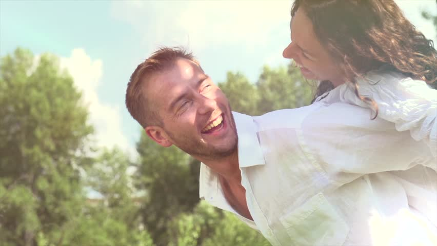 Happy Couple Having Fun Outdoors. Laughing Joyful Family. Freedom Concept. | Shutterstock Video #4285643