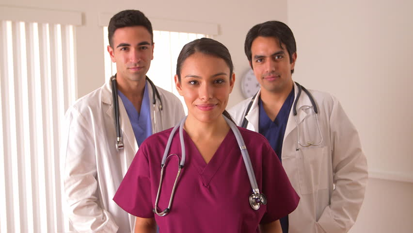 Team of Mexican doctors smiling | Shutterstock HD Video #4286639