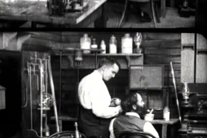 1920s - Re enactment of Thomas Edison inventing the light bulb.