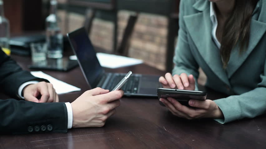 Businesspeople working with smartphone and tablet computer