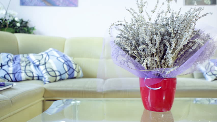 Vase Of Lavender Flower On The Table In Living Room With Sofa Background