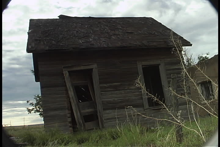 Abandoned House With Broken Door Frame And No Glass In Windows On The Plain Under Low Gray Clouds In Albuquerque, New Mexico. Stock Footage Video 4310759 | ...