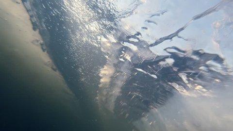 Plunged under Ice in Flowing River Frozen Shelf
