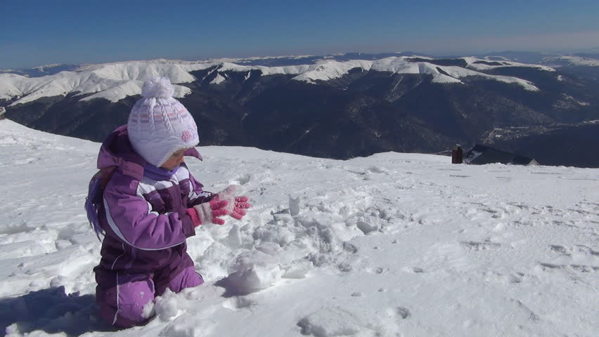 Child Playing in Snow in Mountains, Little Girl in Alpine Area, Winter, Children | Shutterstock HD Video #4325969