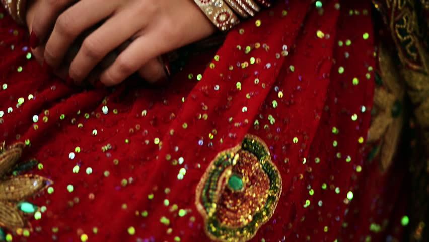 Tilt up shot of a Indian bride smiling and posing