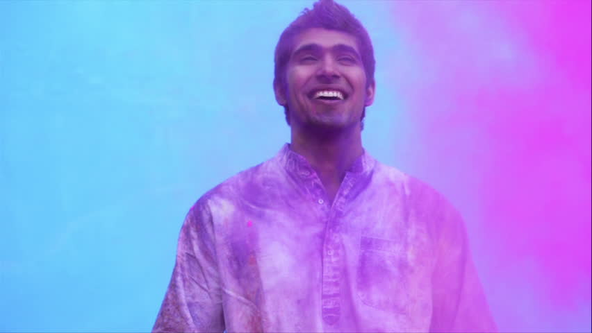 Shot of a smiling man enjoying Holi festival