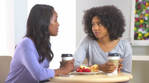 African American friends having conversation at caf\x8E