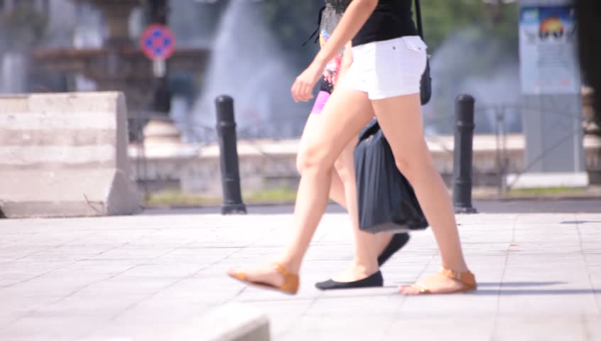 Hot Sexy Legs Of Young Adult Women Walking Down The Street Hot Summer Weather