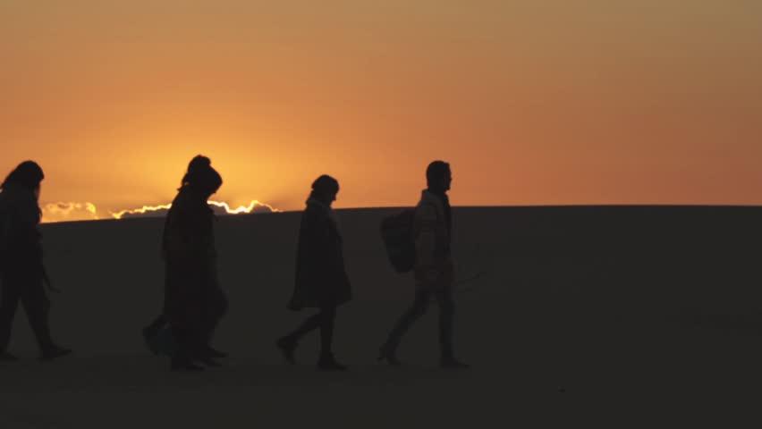 Group walking across desert sunrise. Shot on RED EPIC | Shutterstock HD Video #4354382