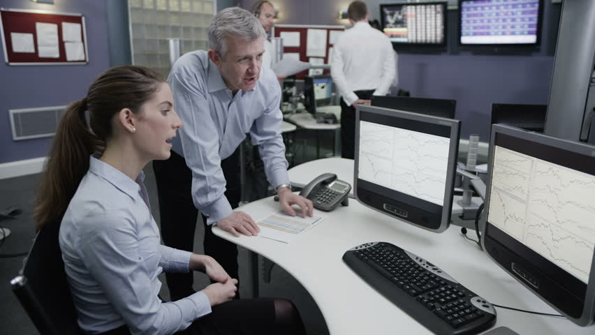 Busy multi ethnic team of financial traders working together and watching the world markets. | Shutterstock HD Video #4362665