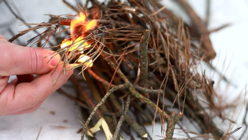 Lighting a fire in the snow  | Shutterstock HD Video #4362779
